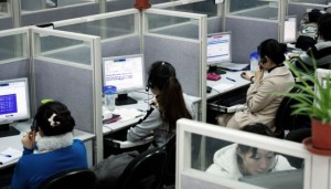 Employees work at a China-based company in the call centre of their headquarters in Shanghai. Andrew Ross/AFP Courtesy: PPP